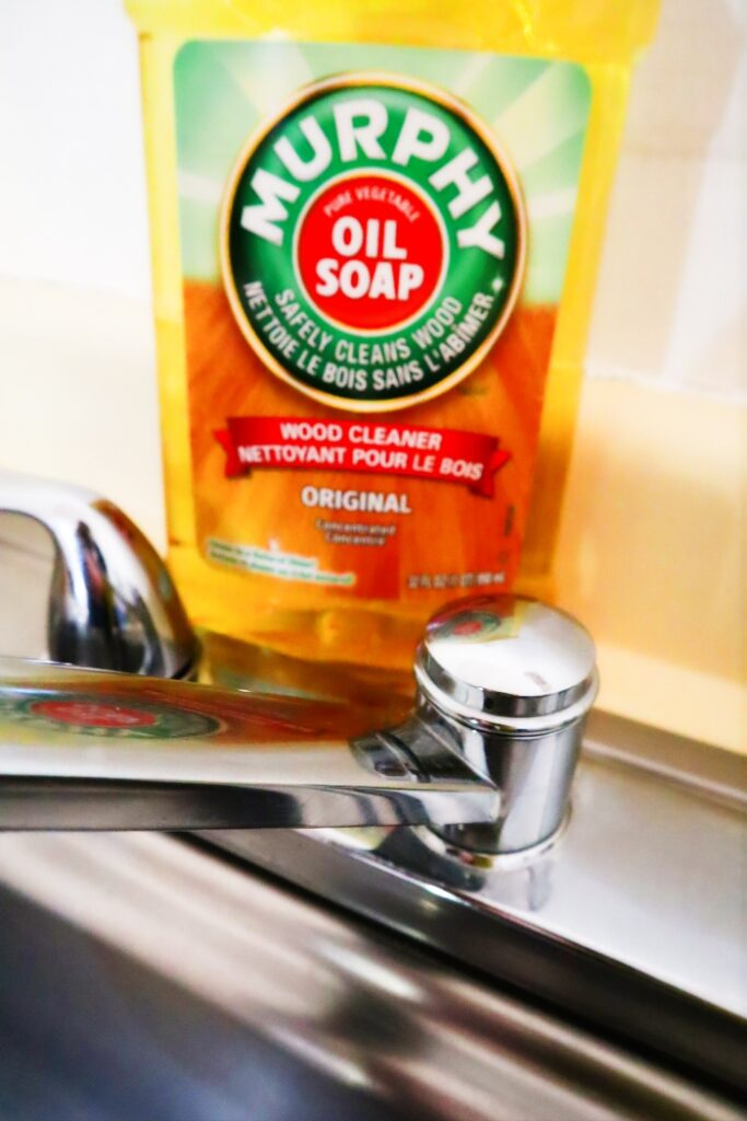 A bottle of Murphy's Oil Soap on the back of a sink