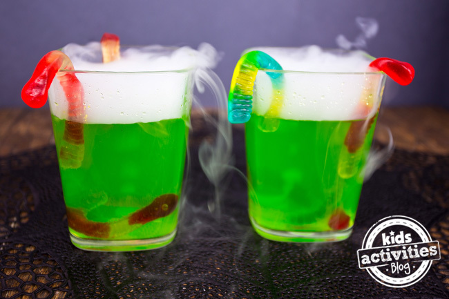 Spooky fog Halloween drinks for kids with gummy worms.