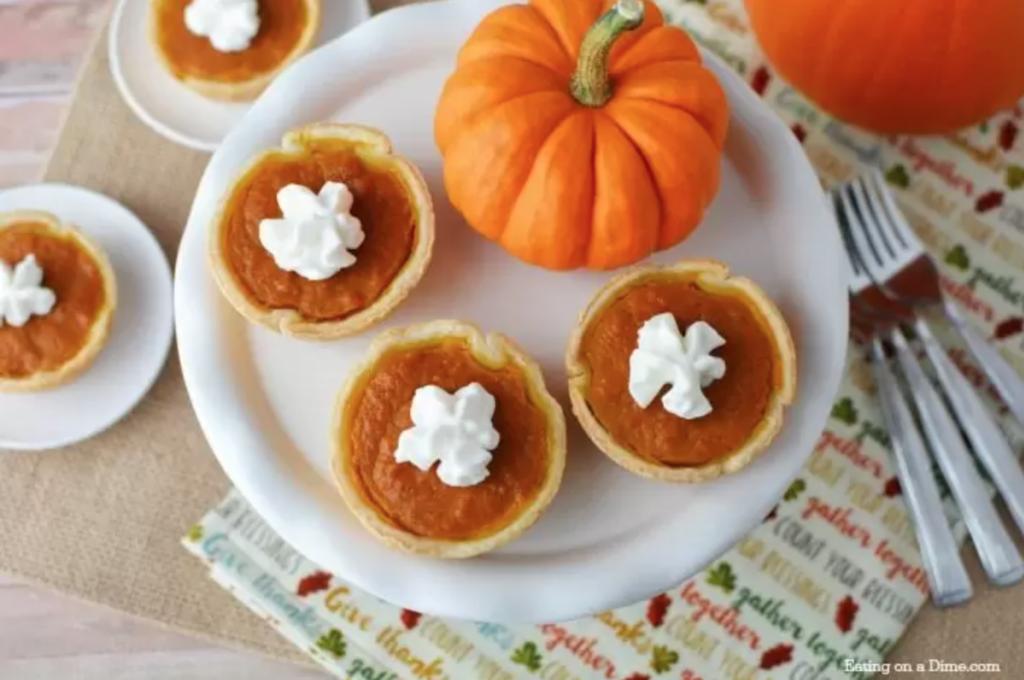 mini pumpkin pies on a plate with a mini pumpkin