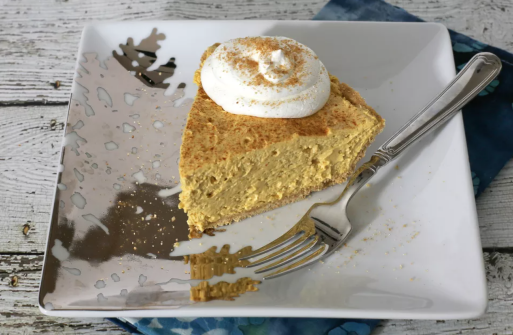 slice of no-bake pumpkin pie on a plate with a fork