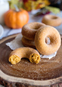 stacked pumpkin spice donuts on a plate