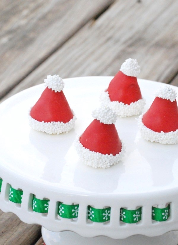 Santa hat Oreo cookie balls on a plate