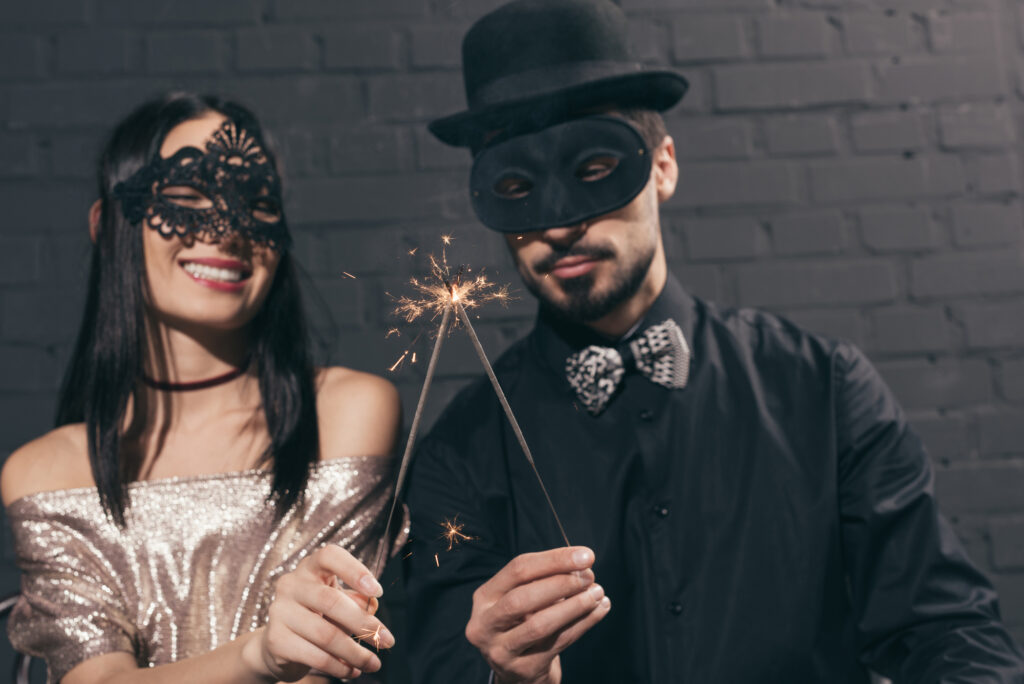 couple dressed for masquerade new year's party theme