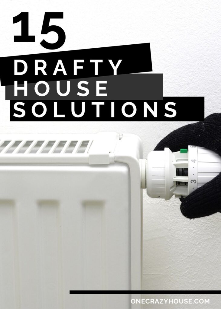 drafty house solutions - gloved hand adjusting thermostat