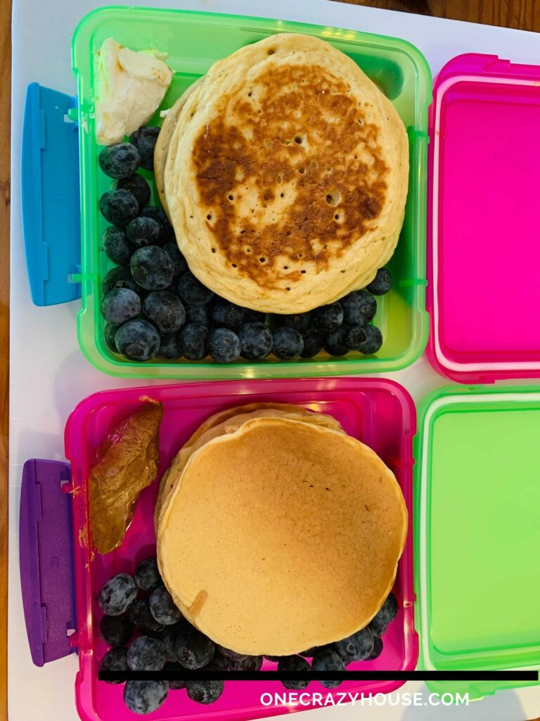 freezer container with individually frozen pancakes and blueberries