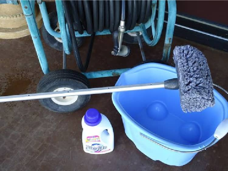 A bucket of water, soft brush and woolite
