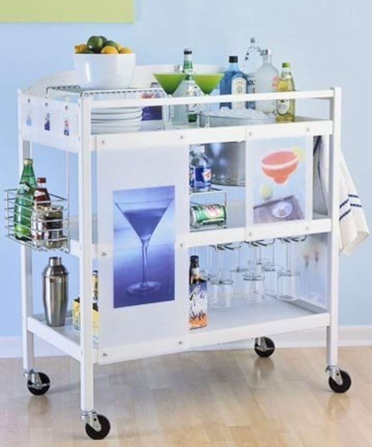 White repurposed changing tables built into a margarita cart with classes and shaker