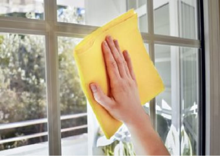 Wiping windows with a microfiber cloth
