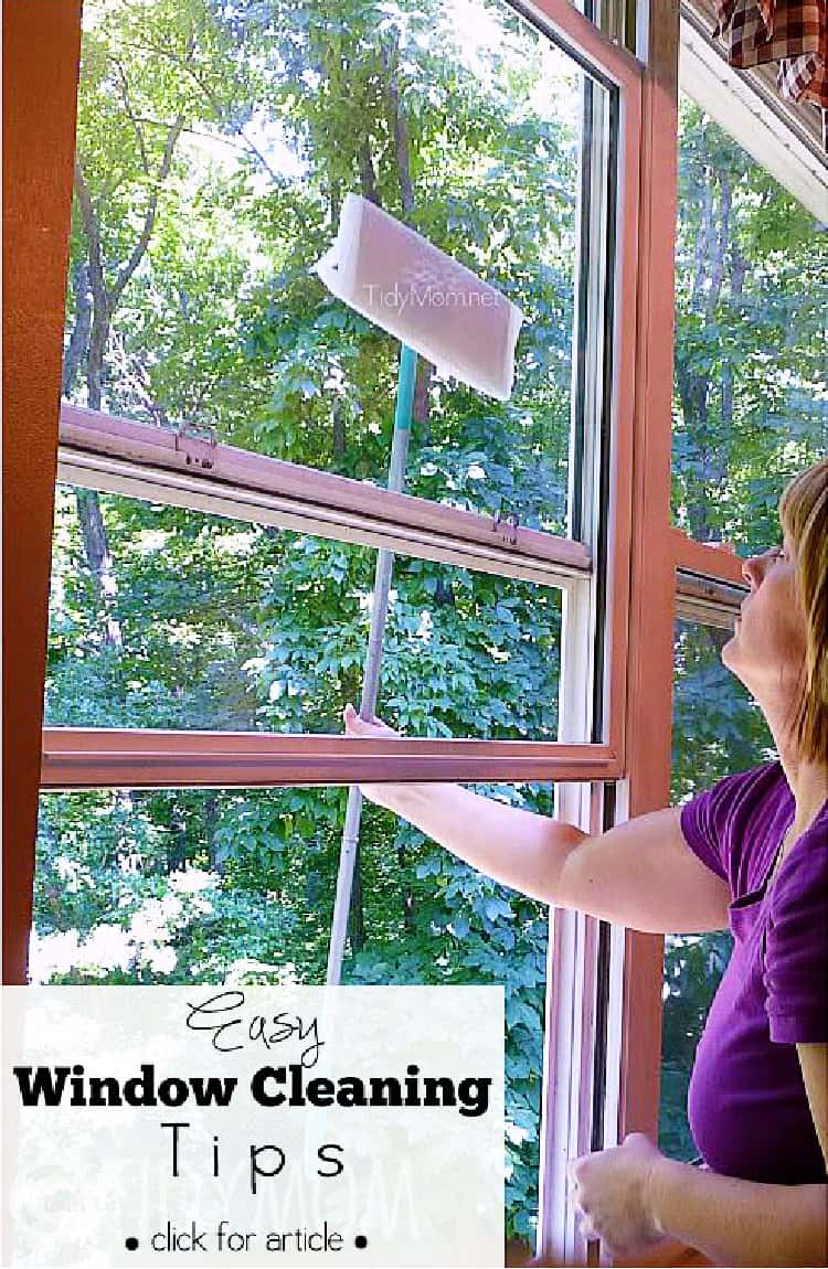 Woman cleaning the outside of their windows with a sponge mop wrapped in paper towels
