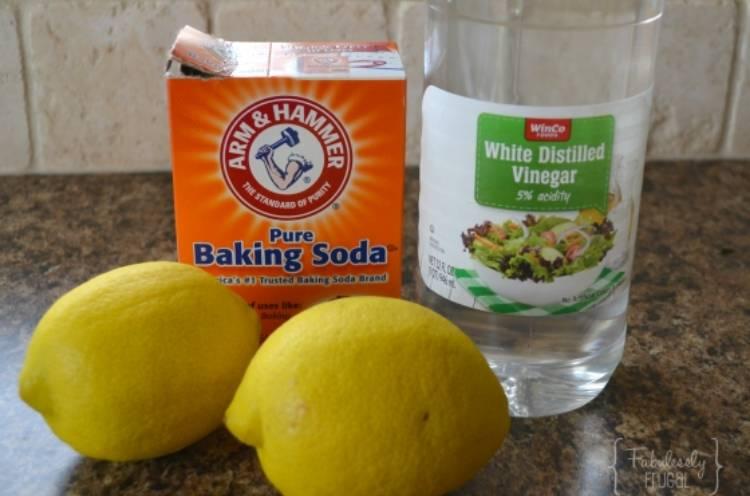 lemon, vinegar, and baking soda to make a DIY cleaning paste