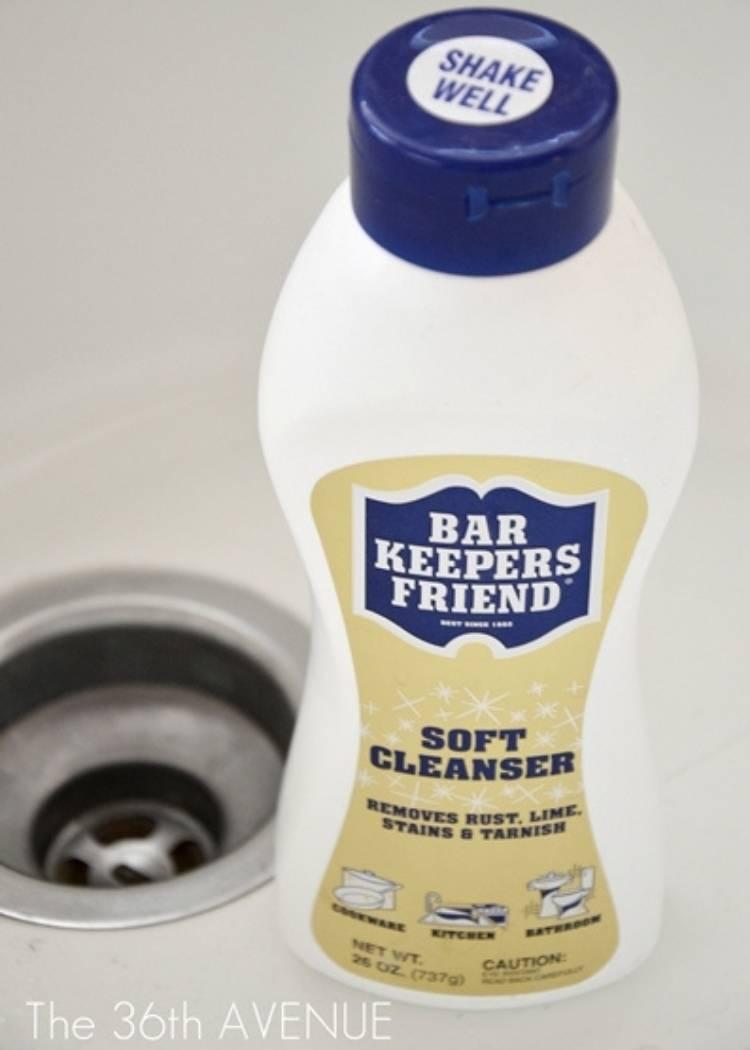 a bottle of bar keeper's friend sink cleanser, bathroom cleaning hack for porcelain sink