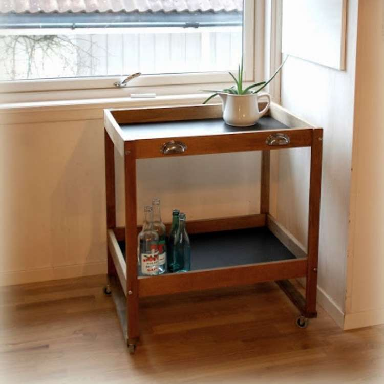 Wooden repurposed changing tables into little rolling cart with lined black tops