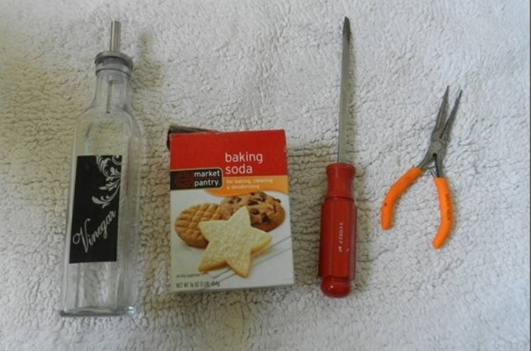 vinger, baking soda, screwdriver, and long nose pliers for cleaning the drain