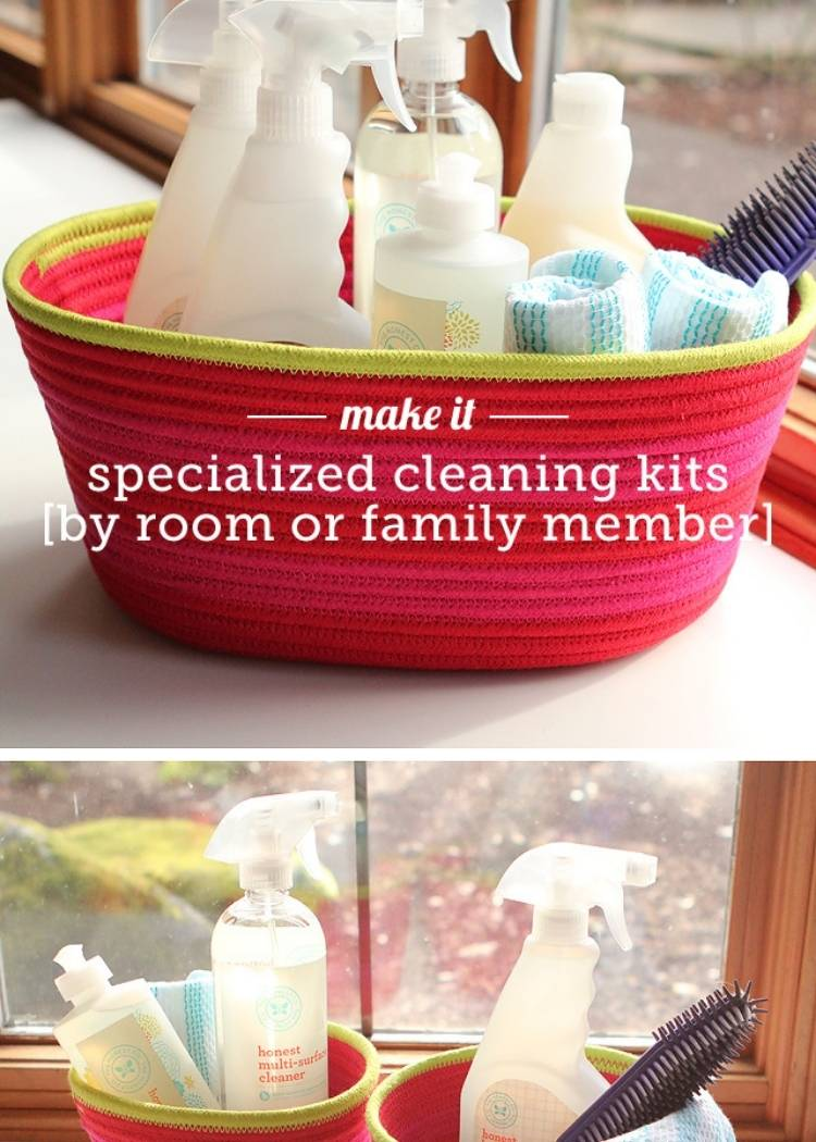 a basket full of cleaning supplies for the bathroom, towels, spray containers, soap