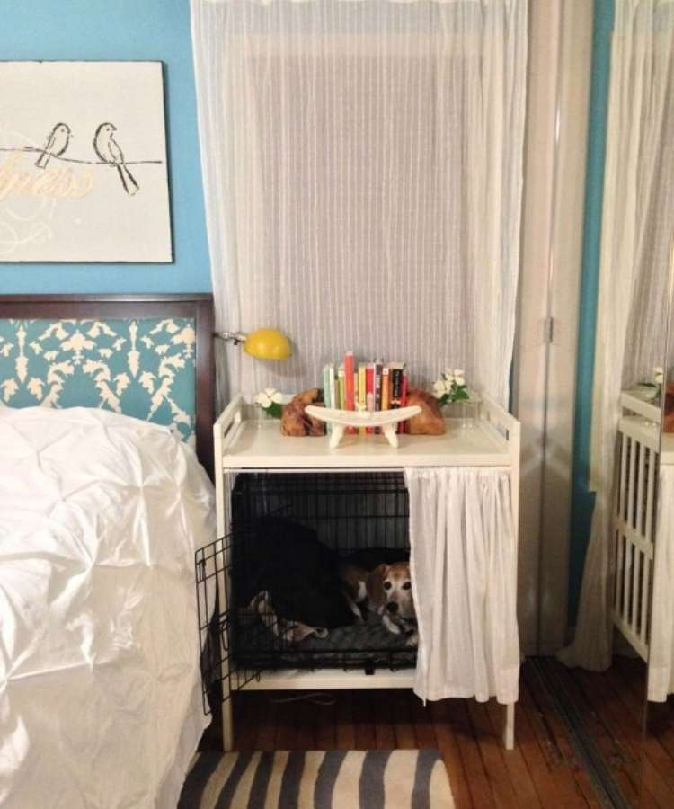 Old white repurposed changing tables redesigned to fit a small wire dog crate hide-a-way