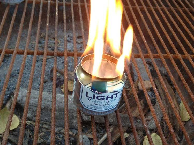 cold-weather-camping image of a beer can used to create a campfire