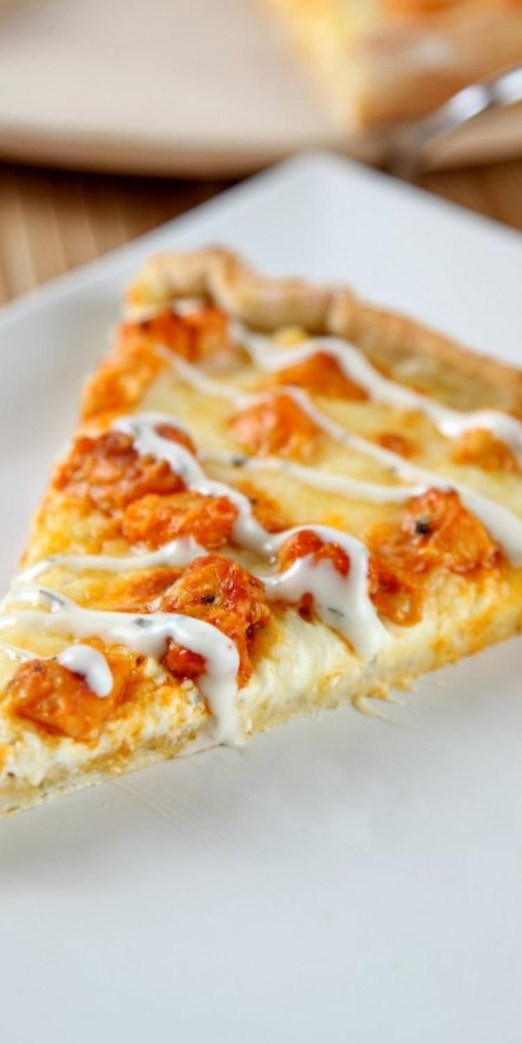 Classic Buffalo Chicken Pizza drizzled with homemade ranch.