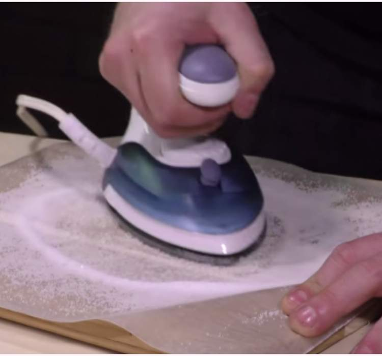 Picture of cleaning iron using salt and wax paper