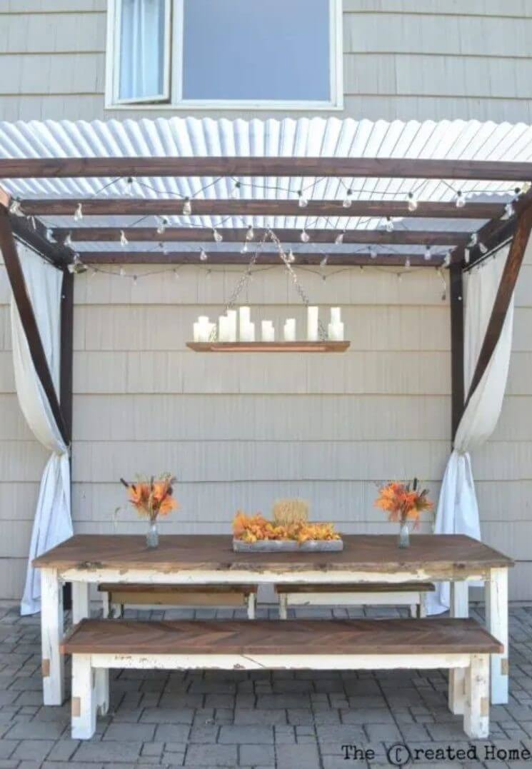Wooden pergola with a table and benches underneath - patio diy ideas