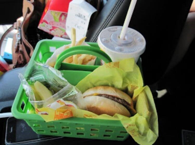 Car hack using a dollar store shower caddy used to organize a fast food meal