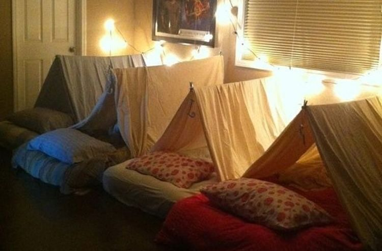 glamping tents with strings of lights for slumber parties