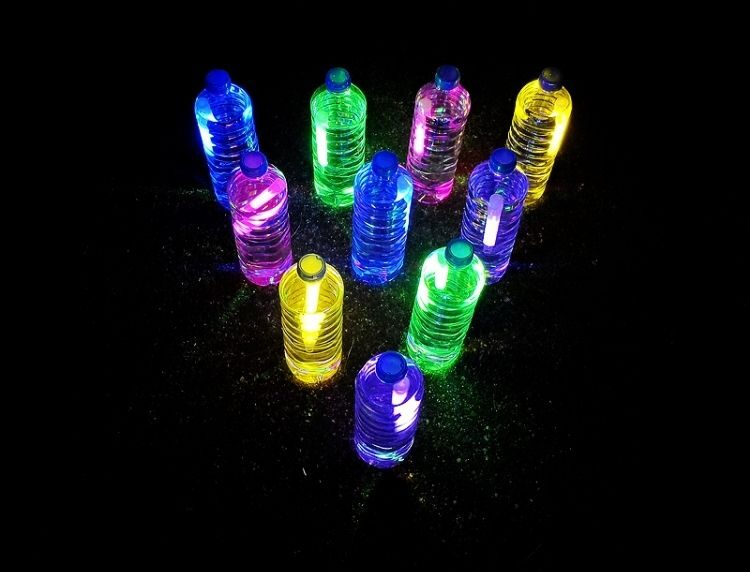 glow in the dark bowling using water bottles and glow sticks