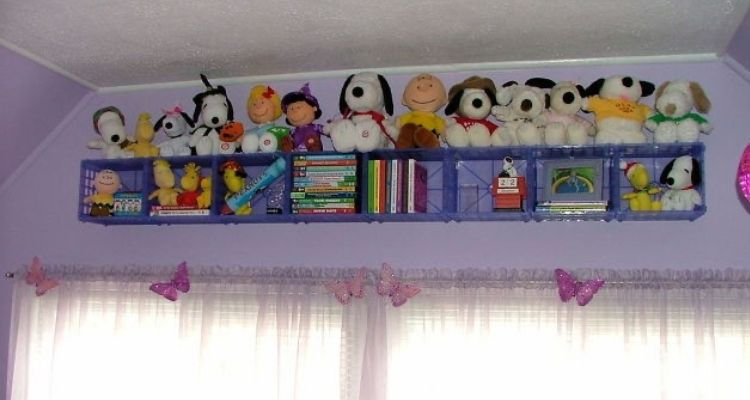 Baskets mounted on a wall for kids room organization