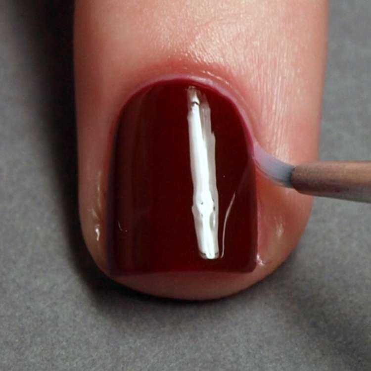 Remove extra polish on cuticles using a nail brush