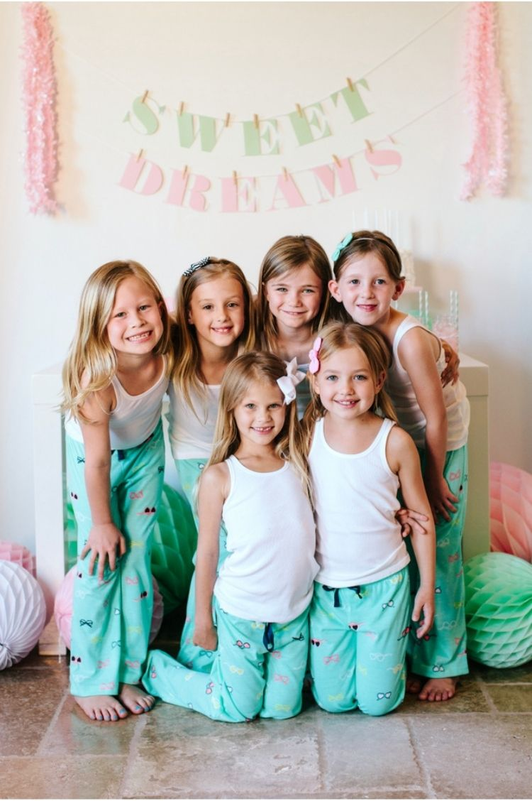 Coordinating pajamas are a very fun sleepover party idea - girls posing in matching pajama sets