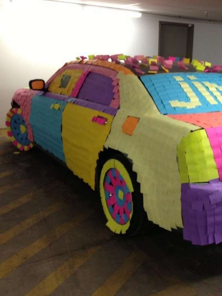Fun Birthday Prank Ideas- Picture of car covered in colorful post-it notes as a prank