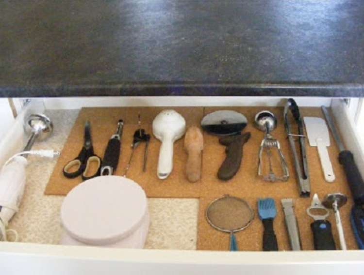 One Crazy House how to Organize Kitchen open drawer with cork board underneath utensils