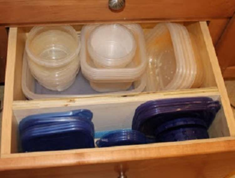 One Crazy House how to Organize Kitchen open kitchen drawer with plastic containers, lids neatly stacked in section divided by wood plank
