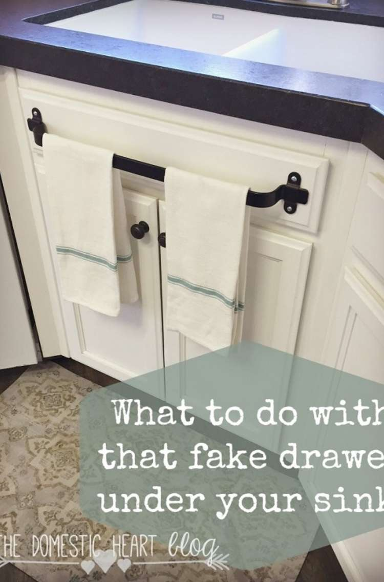 """One Crazy House how to Organize Kitchen front of kitchen cabinets with towel rod added to fake drawer in front of sink. Title card says """"What to do with the fake drawer under your sink"""""""