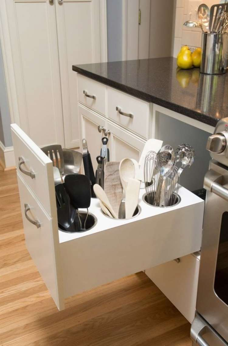 OneCrazyHouse How to Organize Kitchen Deep kitchen drawer next to stove, open, reavealing tall kitchen utensils neatly arranged standing up in drawer