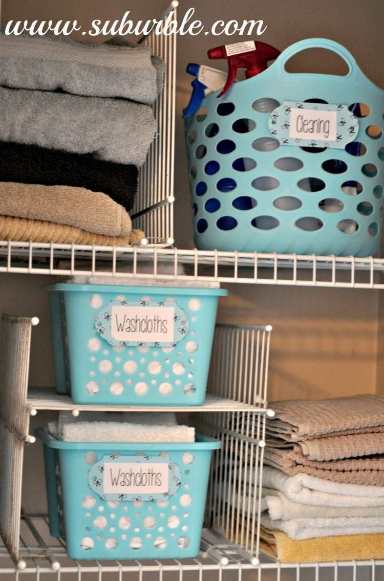 Shelves in a linen closet with baskets, metal shelveing used as dividers for shelf compartments, and creating stackable storage areas