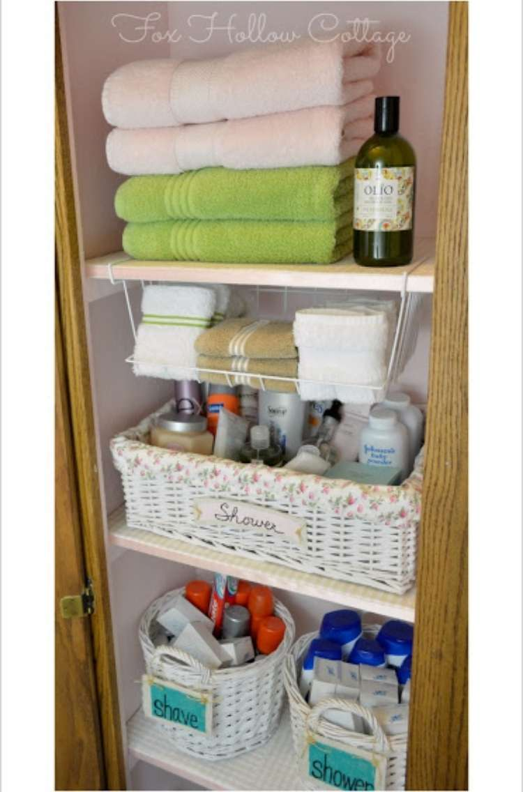 Onecrazyhouse Linen Closet Organization shelves in a linen closet with towels and soap on top shelf, basket on lower shelf and a compartment in between holding hand towels.