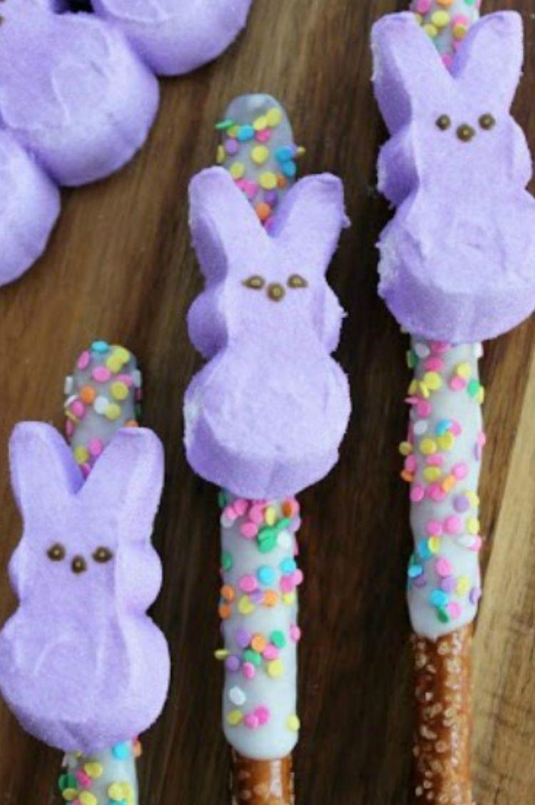 Purple Peeps Bunny marshmallows on top of chocolate covered pretzel sticks