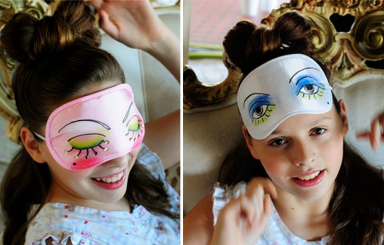 DIY painted sleep mask craft - girl wearing sleep masks she decorated