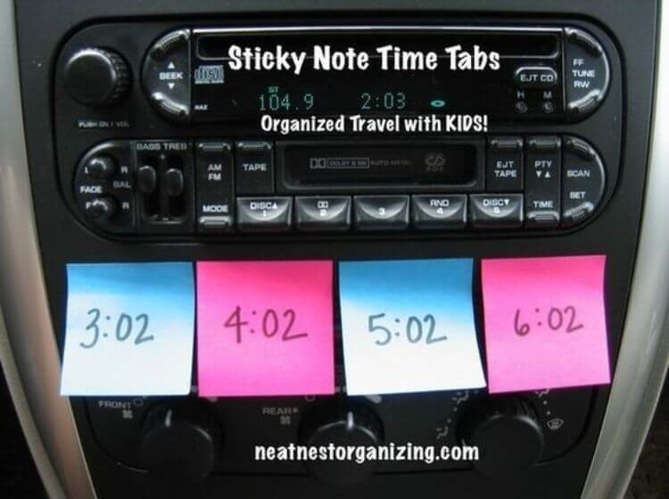 Car hack to keep kids behaving - sticky notes attached to a car dash with times written on them to reward kids