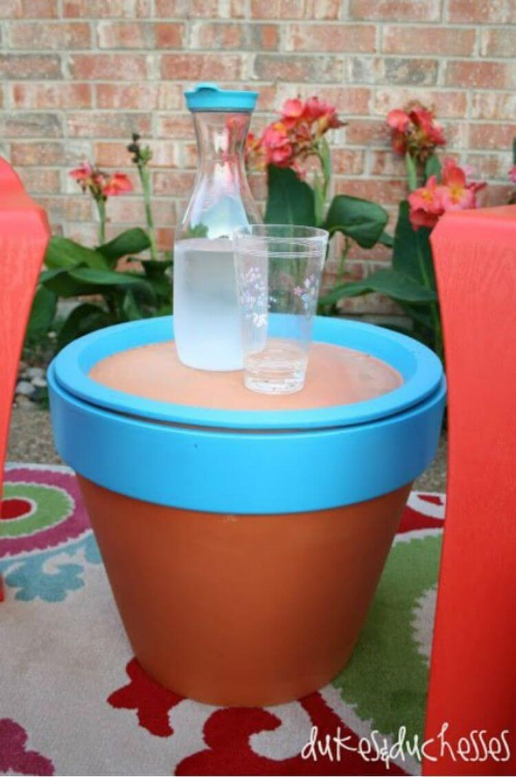 Terracotta pot painted blue with base on top to use as a table - patio diy ideas
