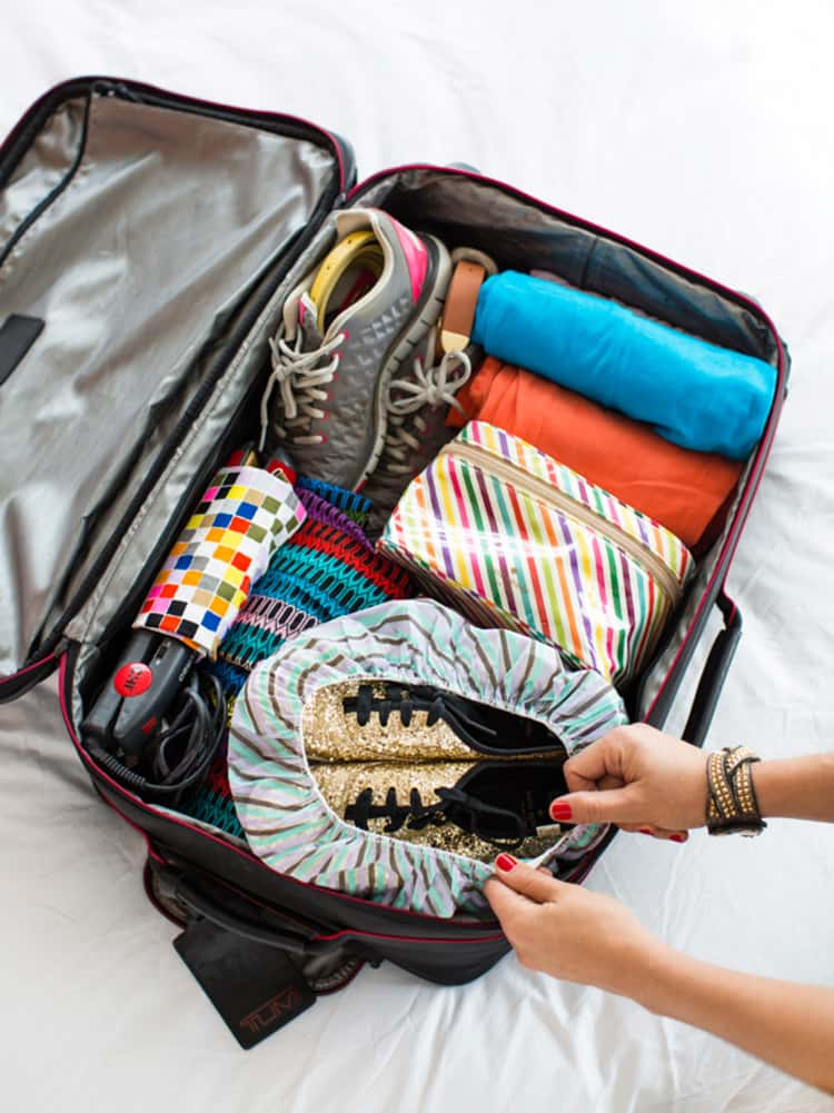 Packing shoes inside a shower cap in your luggage, for easy travel