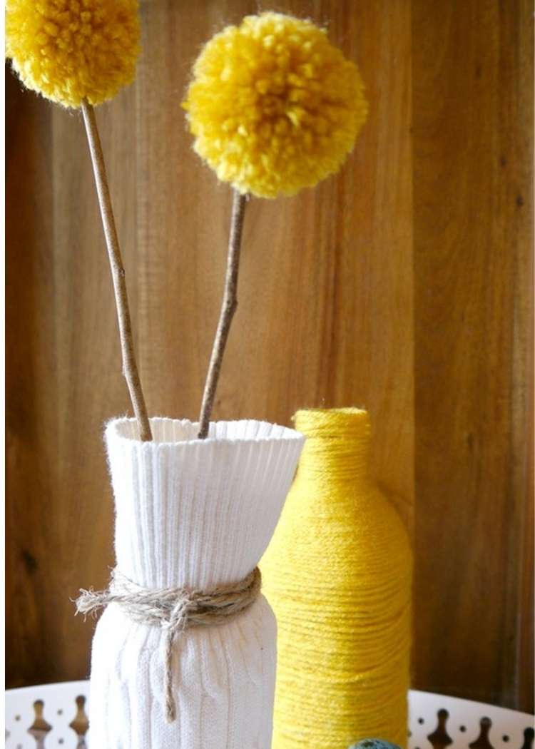 Cool sweater vase made from a bottle and recycled old sweater