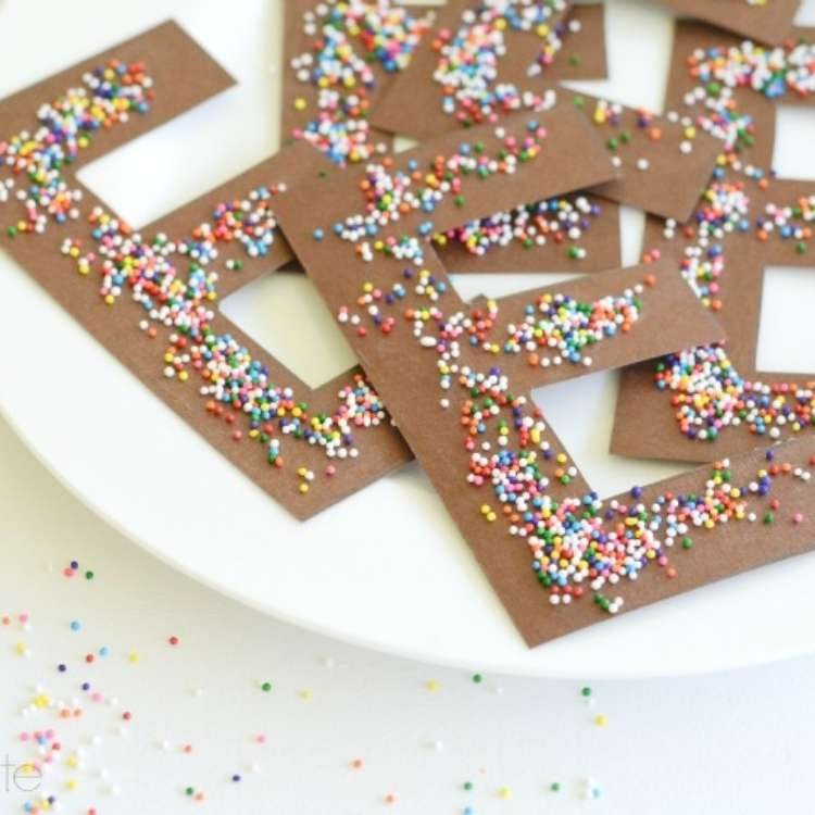 April fools trick, a plate full of paper cut outs of bown Es with candy sprinkles on top