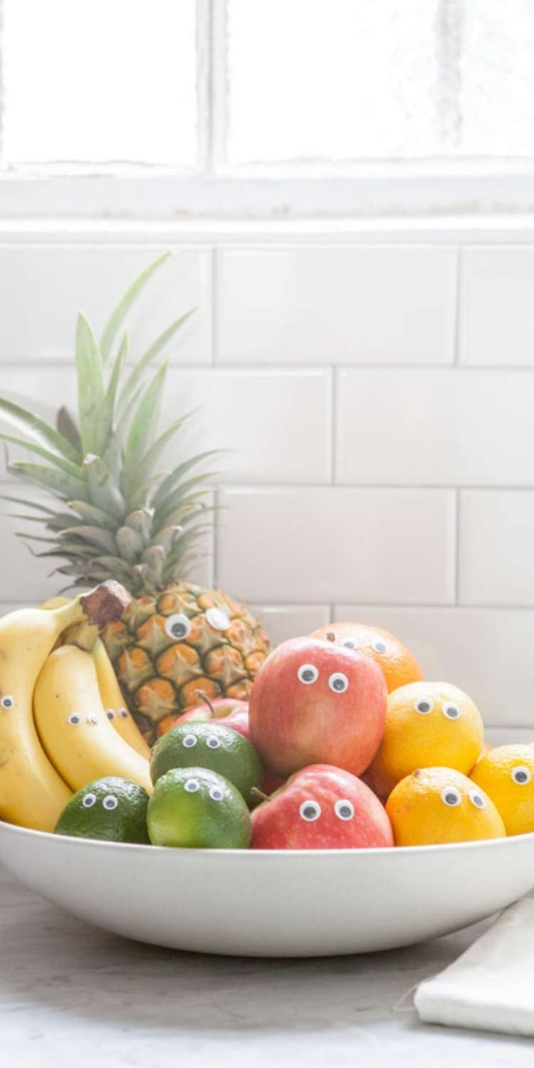 April fools prank, a plate full of fruit with googly eyes to make funny fruit faces