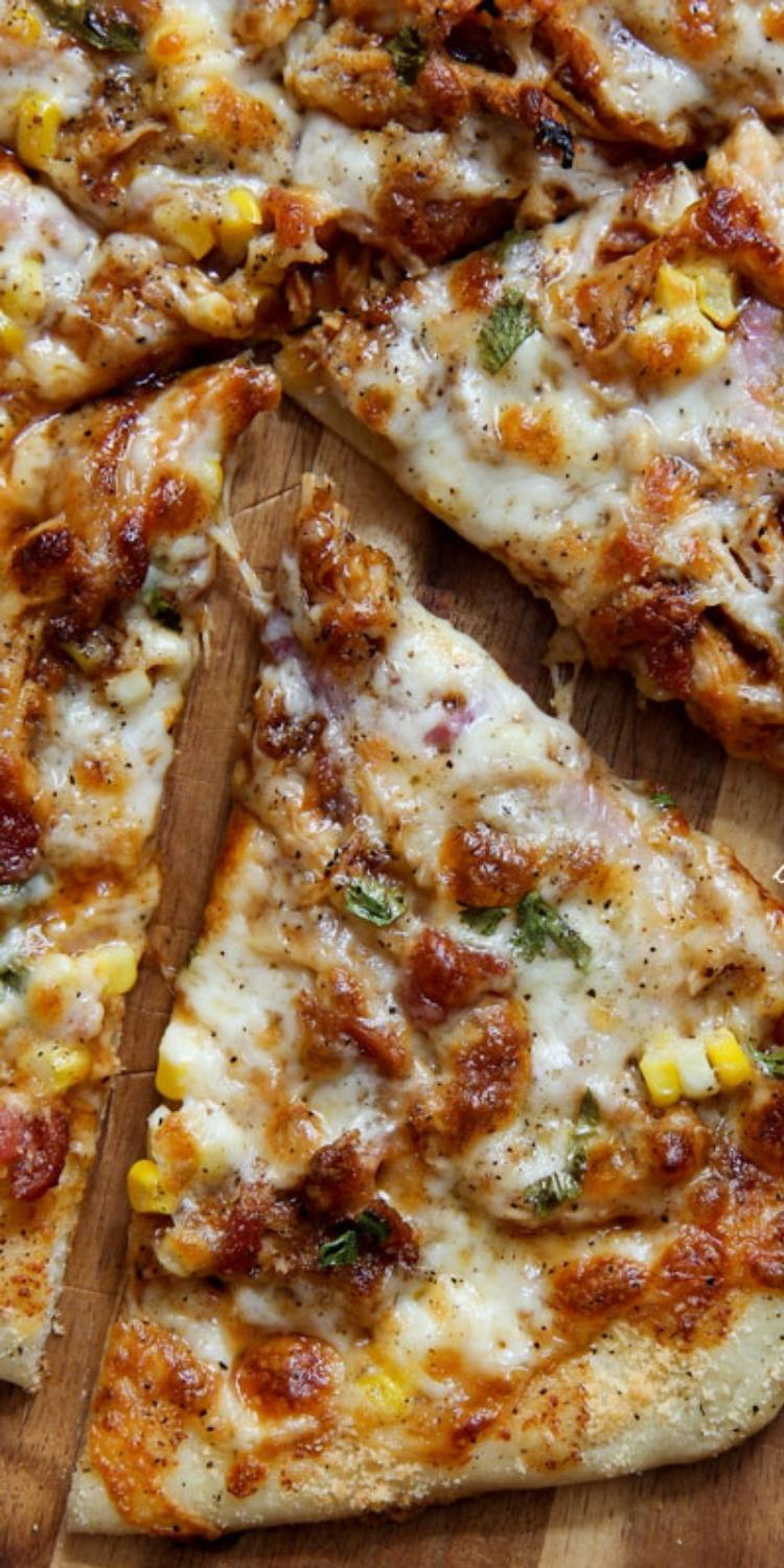 Barbeque bacon and corn atop thin crust pizza. Roasted Corn pizza topping.