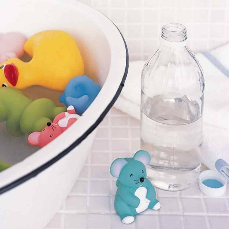 kids' bath toys soaked in warm water with vinegar