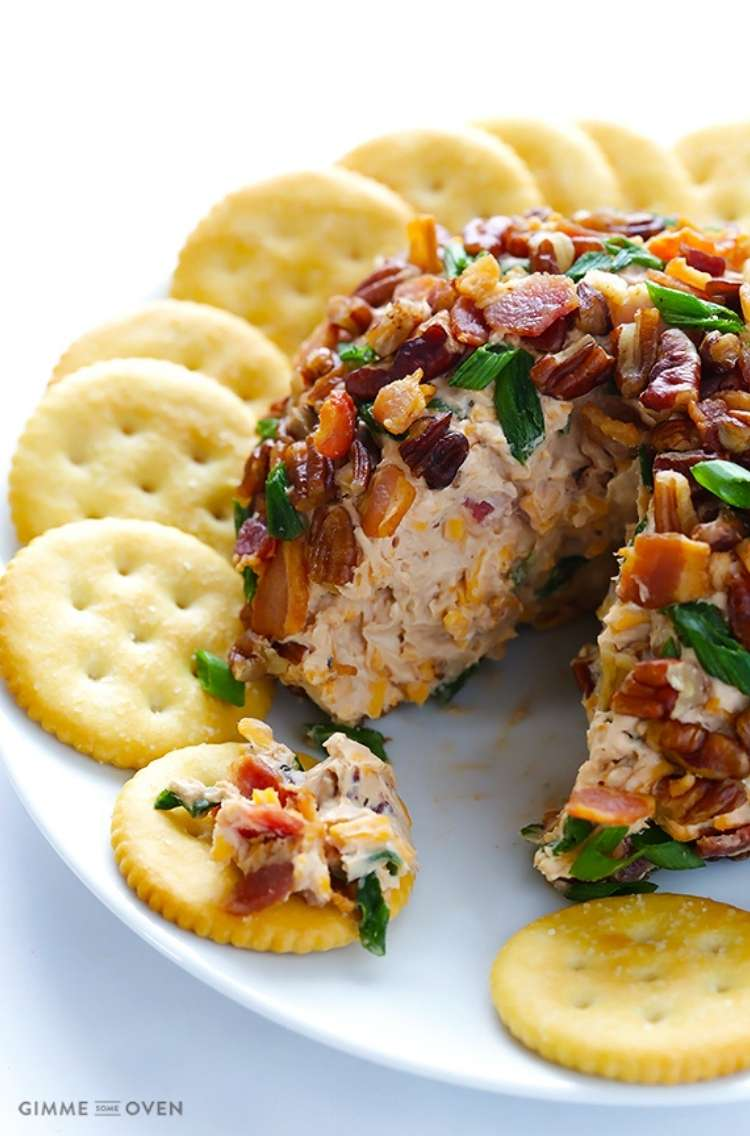 Bbq bacon and cheese ball  on a circle plate with crackers