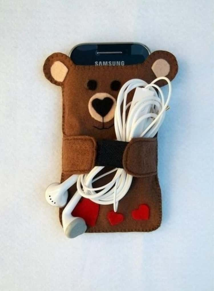DIY felt fabric phone case and earbuds holder in the shape of a bear