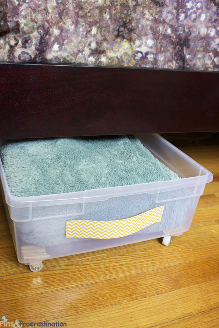 Plastic under-bed storage drawer used to make the most of wasted storage space.