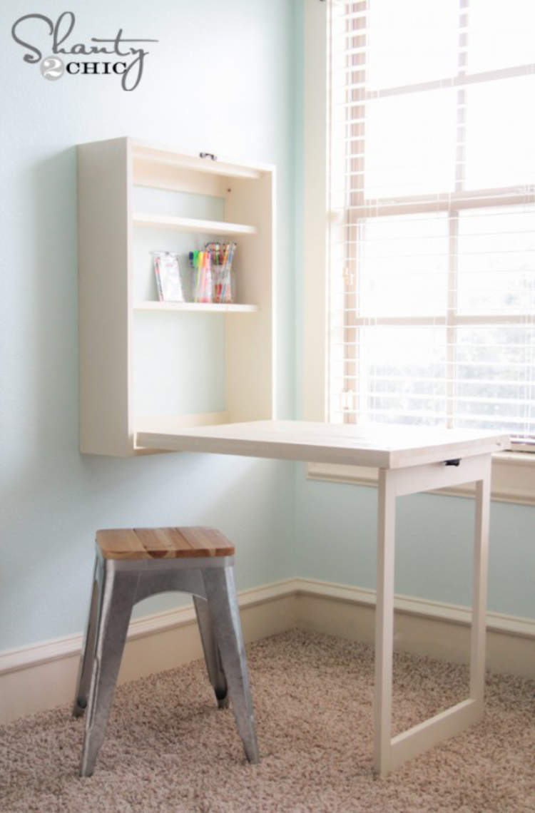 Foldaway desk being used to free up floor space when not in use.
